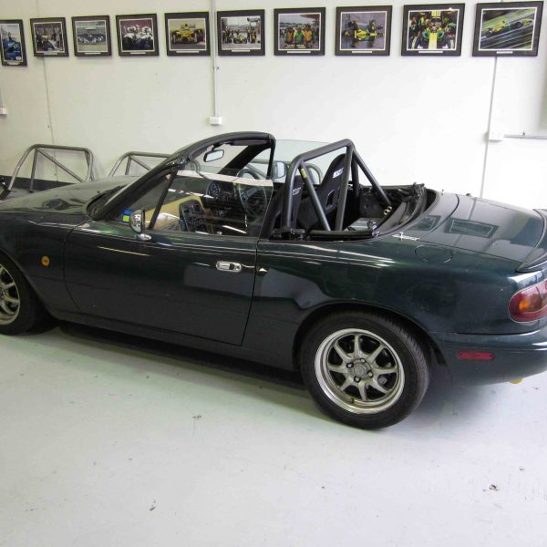 AGI - Mazda MX5 NA - CAMS Bolt-in Half cage with pastic rear window (side view in car)