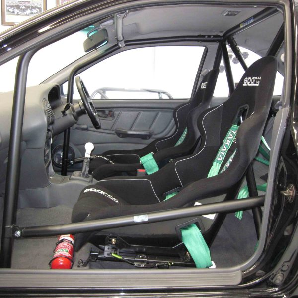 GI-Mitsubishi-Lancer-CC-2dr-2013-CAMS-State-level-Bolt-in-Roll-cage-front-leg-before-dash-in-car-thru-LH-door
